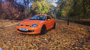 MG LE500 in Vibrant Orange looking fabulous in the autumn leaves